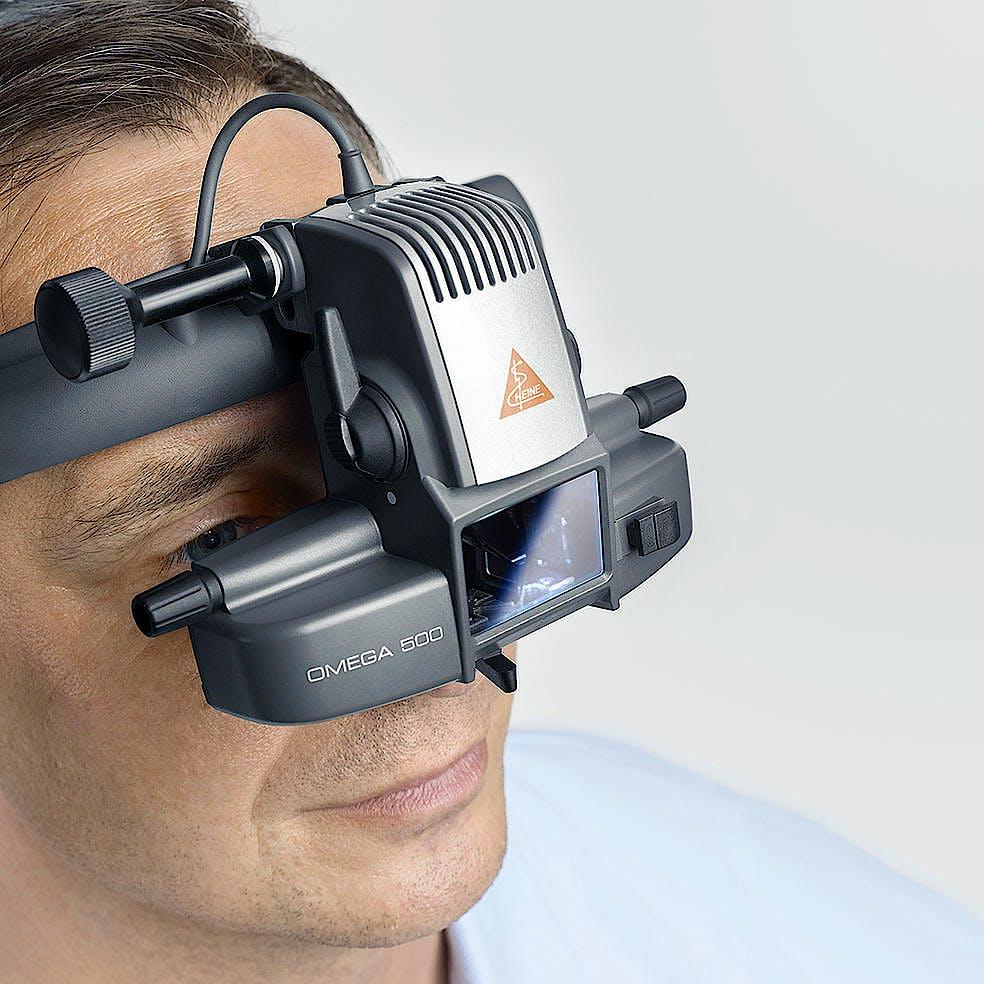 Oftalmoscopio Heine Indirecto Omega500 Kit 2 con HC 50 L y Transf. en 50 Completo, Cable Conexión, Adaptador Ángulo 90º y Soporte Instrumento